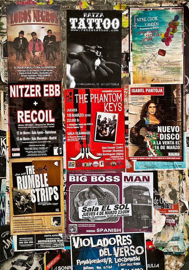 Event posters plastered on a public wall, Madrid, Spain