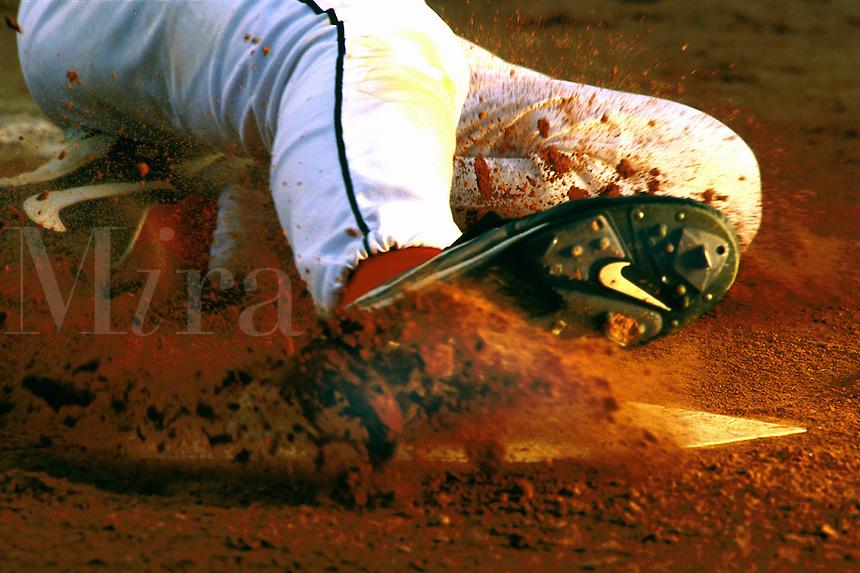 action of baseball player sliding into home plate. Baseball player. Houston Texas.