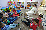 Sister Ferdos Zora sings along with students in a preschool for displaced children run by the Dominican Sisters of St. Catherine of Siena in Ankawa, near Erbil, Iraq.<br /> <br /> The children, and the nuns themselves, were displaced by ISIS from Mosul and Qaraqosh in 2014. The sisters have established a variety of schools and other ministries among the displaced.