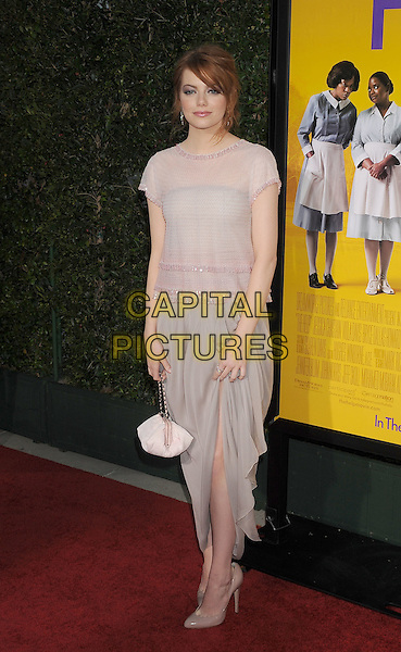 "Emma Stone.arriving at the Los Angeles Premiere of ""The Help"" at the Samuel Goldwyn Theater inside the Academy of Motion Picture Arts and Sciences in Beverly Hills, California, USA, August 9th 2011..full length  grey gray dress white bag  beige nude top skirt pink  shoes .CAP/ROT/TM.©TM/Roth Stock/Capital Pictures"