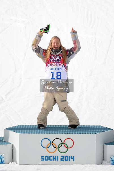 Jamie Anderson (USA)) raises her arms to celebrate during the flower ceremony for her gold medal. Womens Snowboard Slopestyle final - PHOTO: Mandatory by-line: Garry Bowden/SIPPA/Pinnacle - Photo Agency UK Tel: +44(0)1363 881025 - Mobile:0797 1270 681 - VAT Reg No: 768 6958 48 - 090214 - 2014 SOCHI WINTER OLYMPICS - Rosa Khutor Extreme Park, Sochii, Russia