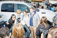 Democratic presidential candidate and Massachusetts senator Elizabeth Warren poses for selfies with supporters after a small rally with supporters outside Graham & Parks School after the candidate voted in the Massachusetts primary as part of Super Tuesday voting in Cambridge, Massachusetts, on Tue., March 3, 2020. The polling place is just a few blocks from Warren's residence. Polls show Warren and Vermont senator Bernie Sanders in a near tie in the Massachusetts Democratic party primary.