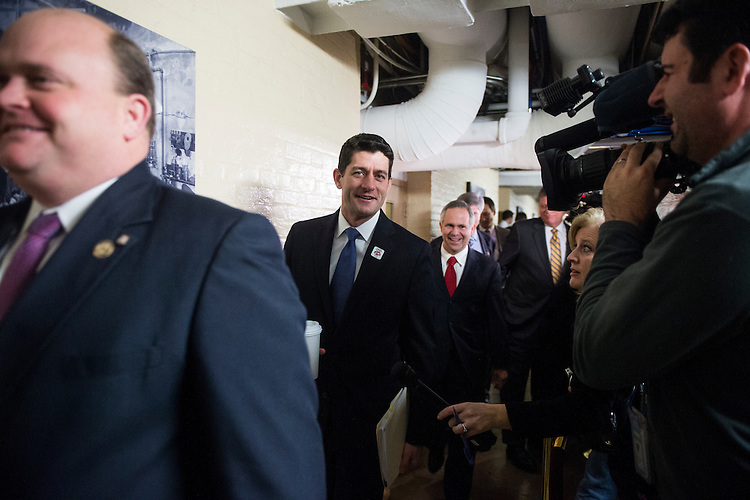 UNITED STATES - JANUARY 1: Rep. Paul Ryan, R-Wisc., center, arrives for the House Republican Conference meeting on the fiscal cliff legislation in the Capitol on Tuesday, Jan. 1, 2013. (Photo By Bill Clark/CQ Roll Call)