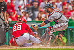 9 June 2013: Minnesota Twins catcher Ryan Doumit gets Washington Nationals outfielder Jayson Werth out at the plate in the 4th inning at Nationals Park in Washington, DC. The Nationals shut out the Twins 7-0 in the first game of their day/night double-header. Mandatory Credit: Ed Wolfstein Photo *** RAW (NEF) Image File Available ***