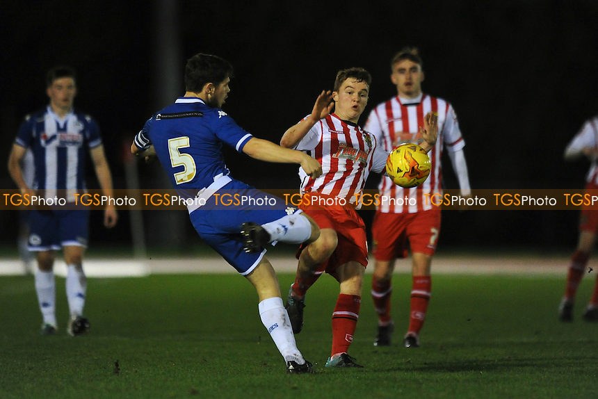 Michael Cregan of Stevenage battles for the ball with Luke Burke of Wigan Athletic during Wigan Athletic Youth vs Stevenage Youth, FA Youth Cup Football at Robin Park Arena, Wigan, England on 17/12/2015