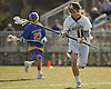 Finn Goonan #11, Northport defender, charges upfield during a Suffolk County varsity boys lacrosse game against West Islip at Veterans Park in East Northport on Monday, Apr. 18, 2016. West Islip won by a score of 10-9.