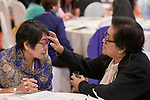 Carminia Gutierrez anoints the forehead of Zenaida Remigio with oil on January 17, 2018, during an international gathering of United Methodist Women in Manila. <br /> <br /> Both women are officers of the United Methodist Women's Society for Christian Service. Remigio is also a deaconess.