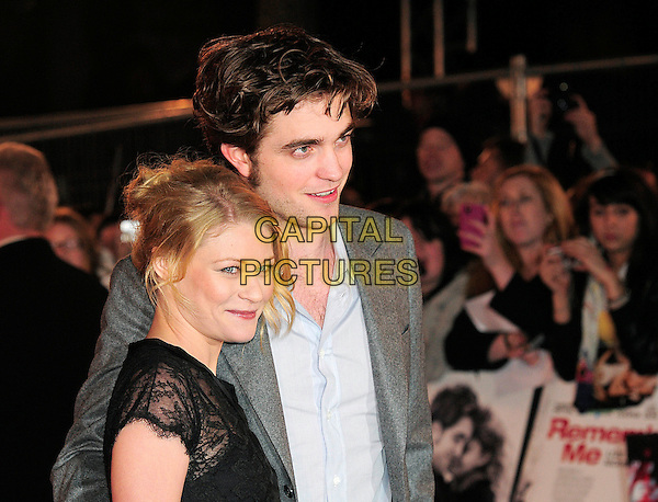 "EMILIE DE RAVIN & ROBERT PATTINSON .UK Premiere of ""Remember Me"" - Arrivals, Odeon Leicester Square, London, England, UK, 17th March 2010..portrait headshot black lace hair up make-up side profile smiling blue shirt grey gray jacket blazer.CAP/BEL.©Tom Belcher/Capital Pictures ."