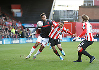 4th January 2020; Griffin Park, London, England; English FA Cup Football, Brentford FC versus Stoke City; Dominic Thompson of Brentford challenges Tyrese Campbell of Stoke City - Strictly Editorial Use Only. No use with unauthorized audio, video, data, fixture lists, club/league logos or 'live' services. Online in-match use limited to 120 images, no video emulation. No use in betting, games or single club/league/player publications