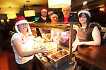SWALEC staff volunteering to serve children from Craigiau School a Christmas lunch at the Claude Hotel in Cardiff..L-R: Ellie Hudson, Gruff Weston, Matt Wittcombe, Val Whitley, Mike Benjifield and Kate Ryan..18.12.12.©Steve Pope