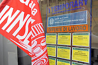 - Milan, demonstration organized by FIOM - CGIL trade union in front of Assolombarda (Industrial Association of Lombardy) in defense of factories in crisis....- Milano, presidio organizzato dal sindacato FIOM - CGIL davanti all'Assolombarda (Associazione degli Industriali Lombardi) in difesa delle fabbriche in crisi