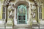 Mausoleum grave with angels and green gate at West London (Brompton) Cemetery, Earls Court, London UK