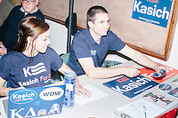Campaign workers register attendees before Republican presidential candidate and Ohio governor John Kasich speaks at a town hall campaign event at Stratham Municipal Center in Stratham, New Hampshire.