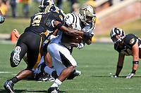 Western Michigan Broncos running back Brandon West attempts to escape the grasp of MU strong safety Justin Garrett  at Memorial Stadium in Columbia, Missouri on September 15, 2007. The Tigers won 52-24.