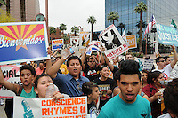 Phoenix, Arizona. April 25, 2012 - Demonstrators chant at the end of the march's route in front of the ICE building on Central Avenue. About 500 people protested the controversial law on the same day U.S. Supreme Court justices heard legal arguments on the Arizona vs. United States case. At the end of the march, six activists blocked Central Avenue by sitting in the middle of the street. They all were arrested by the Phoenix Police Department and taken to the Fourth Avenue County Jail. Photo by Eduardo Barraza © 2012