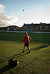Gary Forrest, the Shildon manager punts some balls downfield in preparation for training. 14.9.07