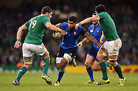 Wesley Fofana of France takes on the Ireland defence. Rugby World Cup Pool D match between France and Ireland on October 11, 2015 at the Millennium Stadium in Cardiff, Wales. Photo by: Patrick Khachfe / Onside Images