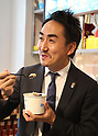 April 27, 2017, Tokyo, Japan - Japan's SNS giant LINE president Takeshi Idezawa tastes an ice dessert after he and Toru Asada, chairman of Mitsukoshi Isetan Transit, a subsidiary of Mitsukoshi Isetan Holdings announced to open a pop-up cafe and character goods shop featuring LINE's famous characters in Tokyo on Thursday, April 27, 2017. The Shinjuku Box, run by Mitsukoshi Isetan Transit, will open cafes of Taiwan's ice dessert shop Ice Monster and US chocolate shop Max Brenner using LINE characters and LINE's character goods shop from April 28 near Shinjuku station.   (Photo by Yoshio Tsunoda/AFLO) LwX -ytd-
