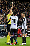 Andreas Pereira of Valencia CF (R) getting the yellow card from Jose Maria Sanchez Martinez FIFA referee during the Copa Del Rey 2017-18 match between FC Barcelona and Valencia CF at Camp Nou Stadium on 01 February 2018 in Barcelona, Spain. Photo by Vicens Gimenez / Power Sport Images