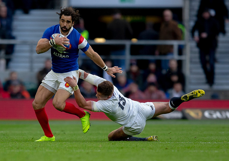 France's Yoann Huget evades the tackle of England's Henry Slade<br /> <br /> Photographer Bob Bradford/CameraSport<br /> <br /> Guinness Six Nations Championship - England v France - Sunday 10th February 2019 - Twickenham Stadium - London<br /> <br /> World Copyright &copy; 2019 CameraSport. All rights reserved. 43 Linden Ave. Countesthorpe. Leicester. England. LE8 5PG - Tel: +44 (0) 116 277 4147 - admin@camerasport.com - www.camerasport.com