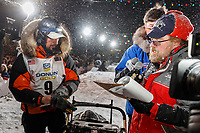 Pete Kaiser signs in at the Nome finish line to win the 2019 Iditarod Trail Sled Dog Race. Pete's winning time is 9 days 12 hours 39 minutes and 6 seconds<br /> <br /> Photo by Jeff Schultz/  (C) 2019  ALL RIGHTS RESERVED