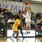 SIOUX FALLS, SD - DECEMBER 7: Trevon Evans #4 from the University of Sioux Falls spots up fro a jumper over Jalen Mobley #11 from Concordia St. Paul during their game Friday night at the Stewart Center in Sioux Falls, SD. (Photo by Dave Eggen/Inertia)