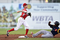 Batavia Muckdogs second baseman Brian Anderson (8) turns a double play as Darren Seferina (29) slides in during a game against the State College Spikes on July 3, 2014 at Dwyer Stadium in Batavia, New York.  State College defeated Batavia 7-1.  (Mike Janes/Four Seam Images)