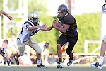 Beverly Hills, CA 09/23/11 - A.J. Hezlep (Peninsula #55) and unknown Beverly Hills player(s) in action during the Peninsula-Beverly Hills frosh football game at Beverly Hills High School.