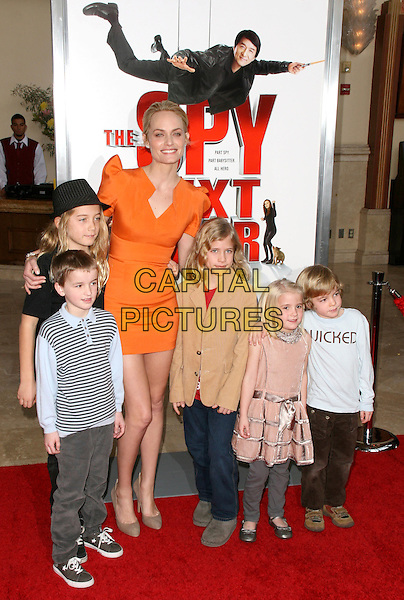"AUDEN & AMBER VALLETTA with nephews & nieces.at  the World Premiere of ""The Spy Next Door"" held The Grove in Los Angeles, California, USA, January 9th, 2010..full length orange dress black hat family son .CAP/RKE/DVS.©DVS/RockinExposures/Capital Pictures"