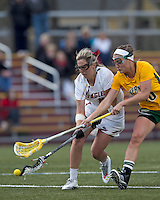 Boston College attacker Kelly McNelis (3) and University of Vermont midfielder Marcie Marino (16) battle for ball. Boston College defeated University of Vermont, 15-9, at Newton Campus Field, April 4, 2012.