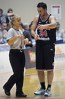 Jeremy Kench discusses rulings with an umpire during the national basketball league match between Wellington Saints and Canterbury Rams at TSB Bank Arena, Wellington, New Zealand on Friday, 13 June 2014. Photo: Dave Lintott / lintottphoto.co.nz