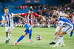 Yannick Ferreira Carrasco (c) of Atletico de Madrid fights for the ball with Sergio Canales Madrazo (l) of Real Sociedad during their La Liga match between Atletico de Madrid vs Real Sociedad at the Vicente Calderon Stadium on 04 April 2017 in Madrid, Spain. Photo by Diego Gonzalez Souto / Power Sport Images