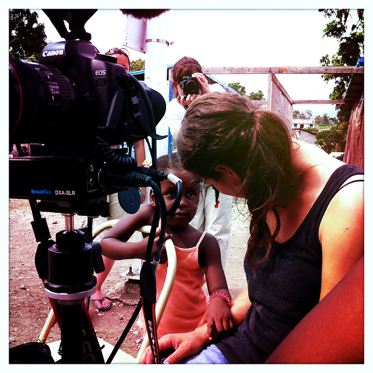 10x10 Field Producer Gina Nemirofsky, talking with a girl in Haiti.