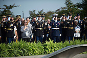 Members of the military salute as United States President Barack Obama lays a wreath at the Pentagon in remembrance of the12th anniversary of the 9/11 terrorist attacks, at the Pentagon on September 11, 2013 in Arlington, Virginia. <br /> Credit: Kevin Dietsch / Pool via CNP