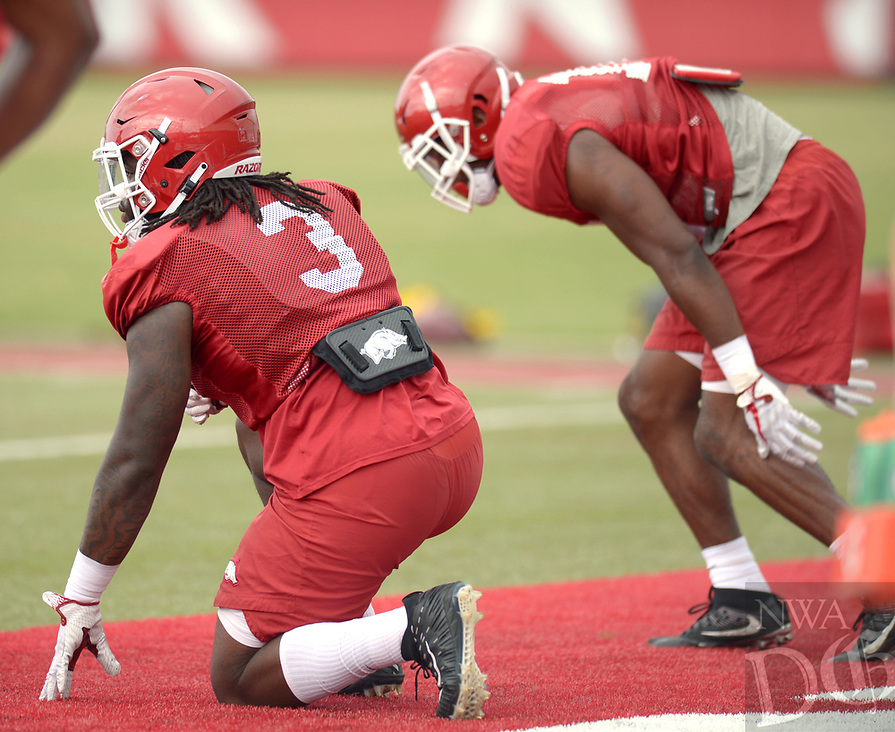 NWA Democrat-Gazette/ANDY SHUPE<br /> Arkansas defensive lineman McTelvin Agim (3) participates in a drill Tuesday, Aug. 7, 2018, during practice at the university practice fields in Fayetteville. Visit nwadg.com/photos to see more photographs from the practice.
