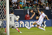 Mexico's Javier Hernandez gets off a shot on Costa Rica goalkeeper Keylor Navas while being pressured by Costa Rica's Jhonny Acosta.  Mexico defeated Costa Rica 4-1 at the 2011 CONCACAF Gold Cup at Soldier Field in Chicago, IL on June 12, 2011.