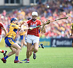 Podge Collins of Clare in action against Luke Meade of Cork during their Munster senior hurling final at Thurles. Photograph by John Kelly.