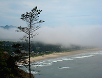 An overlook along highway 101 reveals the cloud covered beach town of Manzanita, Oregon, USA.