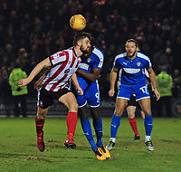 Lincoln City's Luke Waterfall vies for possession with Notts County's Shola Ameobi<br /> <br /> Photographer Andrew Vaughan/CameraSport<br /> <br /> The EFL Sky Bet League Two - Lincoln City v Notts County - Saturday 13th January 2018 - Sincil Bank - Lincoln<br /> <br /> World Copyright &copy; 2018 CameraSport. All rights reserved. 43 Linden Ave. Countesthorpe. Leicester. England. LE8 5PG - Tel: +44 (0) 116 277 4147 - admin@camerasport.com - www.camerasport.com