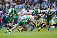 George Lowe of Harlequins is brought down by Tom Cruse of London Irish during the Aviva Premiership match between London Irish and Harlequins at the Madejski Stadium on Sunday 1st May 2016 (Photo: Rob Munro/Stewart Communications)