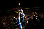 Lucha Libre AAA wrestler Vampiro is swarmed by fans when he takes to the stands in San Jose, CA March 29, 2009.