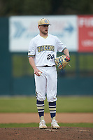 Queens Royals relief pitcher Nick Nelson (24) looks to his catcher for the sign against the Mars Hill Lions at Intimidators Stadium on March 30, 2019 in Kannapolis, North Carolina. The Royals defeated the Bulldogs 11-6 in game one of a double-header. (Brian Westerholt/Four Seam Images)