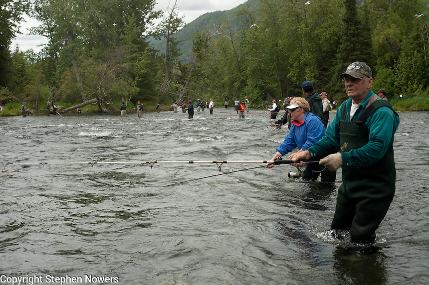 Anglers combat fish for red salmon on Alaska's Russian River.