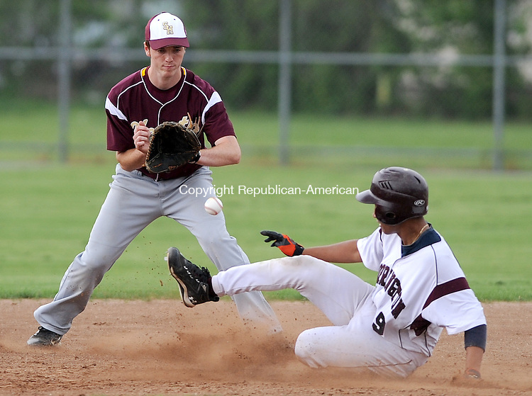 TORRINGTON,  CT, 14 MAY 2012-051412JS05- Torrington's Victor Rodriguez (9) safely steals second as Sacred Heart's Alan Naylor (11) fields the ball during their game Monday at Fuessenich Park in Torrington. .Jim Shannon Republican-American