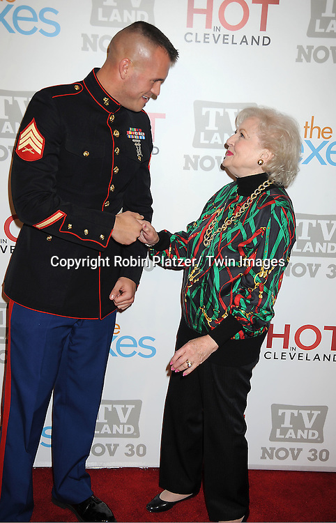 """Sargeant Eric Worth and Betty White attend the TV Land Party for the  premieres of """"Hot In Cleveland"""" and """"The Exes""""  on November 29, 2011 at SD26 in New York City. the party also celebrated Toys for Tots."""