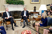 United States President Barack Obama, center, with US Vice President Joe Biden, left, and Dr. Jill Biden, right, meet to discuss the release of the Cancer Moonshot Report in the Oval Office of the White House on October 17, 2016 in Washington, DC. <br /> Credit: Olivier Douliery / Pool via CNP