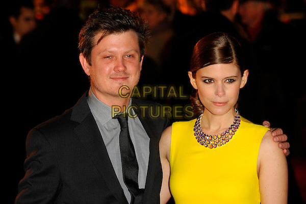 Beau Willimon and Kate Mara.'House of Cards' Netflix Gala Screening at the Odeon West End, Leicester Square, London, UK,.January 17th 2012..portrait headshot necklace  grey gray black tie shirt purple yellow .CAP/CJ.©Chris Joseph/Capital Pictures.