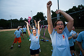 2 Legit 2 Kick Co-Captain Missy Wheeler, center, celebrates along with Meghan Dillon, right, following a run during a kick ball match at Pullen Park, Tues., Aug. 28, 2008.