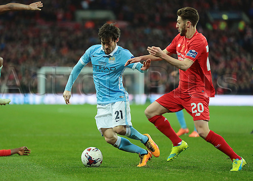 28.02.2016. Wembley Stadium, London, England. Capital One Cup Final. Manchester City versus Liverpool. Manchester City Midfielder David Silva feels pressure from  Liverpool Midfielder Adam Lallana