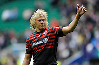 Mouritz Botha of Saracens thanks fans on a victory lap after winning the Heineken Cup semi-final match between Saracens and ASM Clermont Auvergne at Twickenham Stadium on Saturday 26th April 2014 (Photo by Rob Munro)